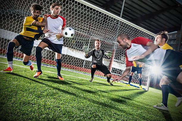 Football match in stadium: Header goal stock photo