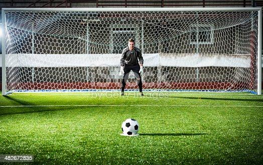Football match in stadium: Penalty kick