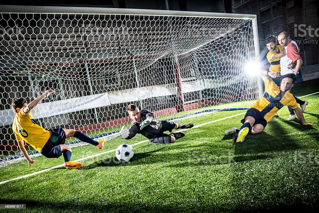 Football match in stadium: Striker's goal stock photo