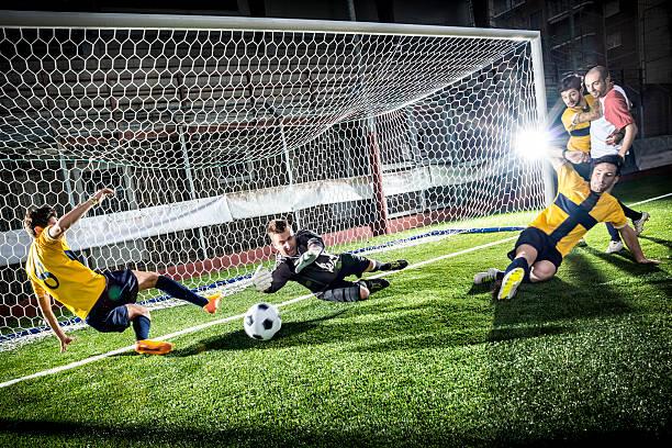 Football match in stadium: Striker's goal stock photo