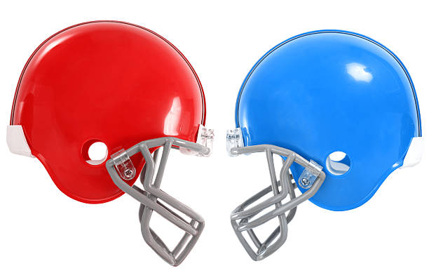 Football Matchup 2 Football Helmets going head to head, easy to adjust colors by adjusting the hue values. football helmet stock pictures, royalty-free photos & images