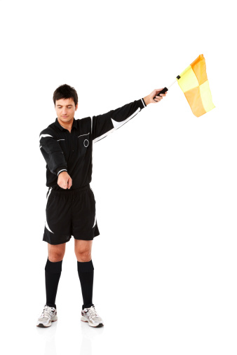 Image of football official signals a penalty with a colorful flag isolated on white background