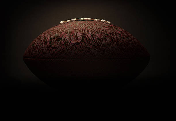 Football on a black background stock photo