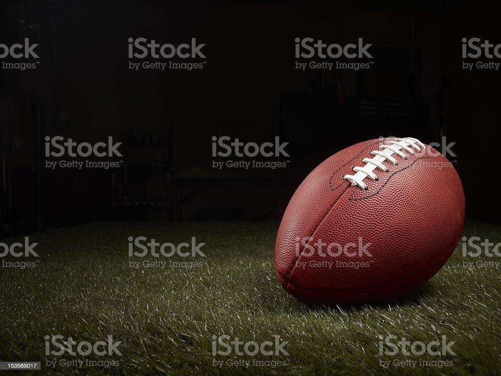 football on a grass field stock photo