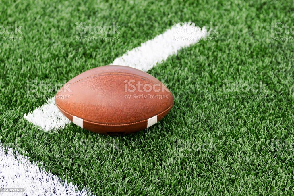Football on a green turf field stock photo