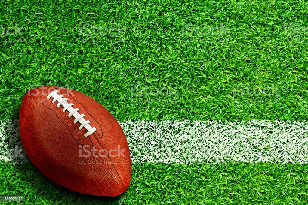 Football on Field With Copy Space stock photo