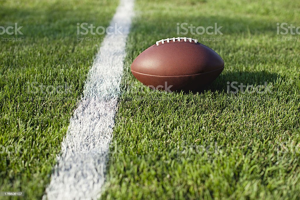 Football on grass field at goal or yard line stock photo