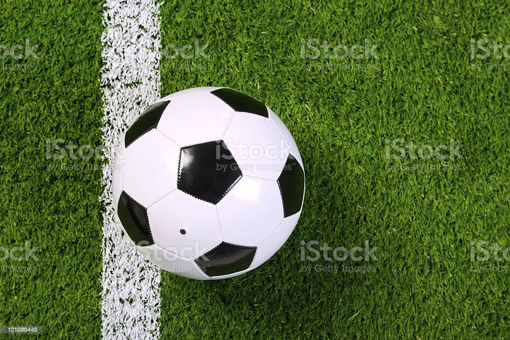 Football on grass from above. stock photo