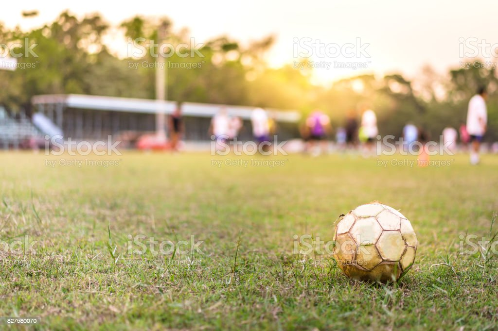 Football on green grass. Soccer football field withe blur people,...