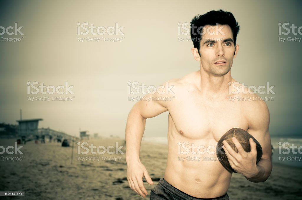 Football on the beach. (XL) royalty-free stock photo