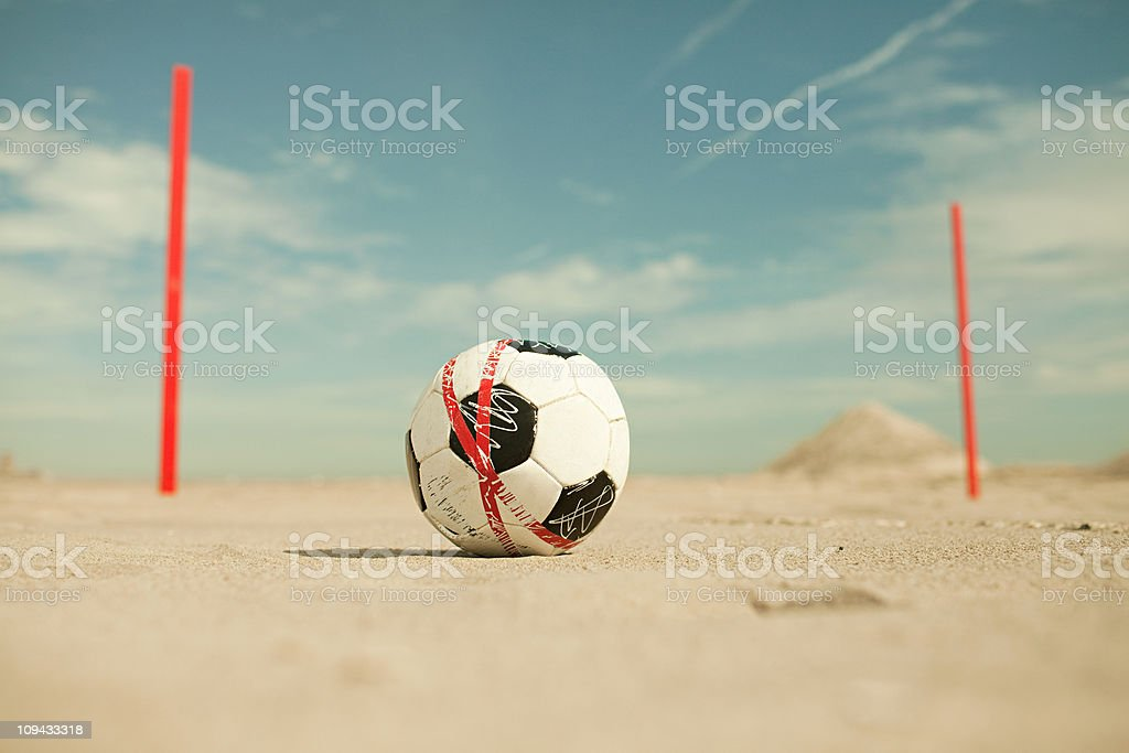 Football on the sand on beach royalty-free stock photo
