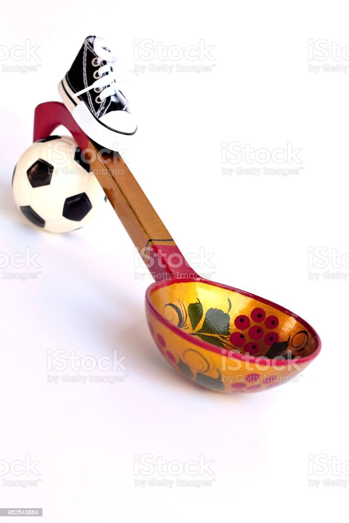 314f86b92 Football Or Soccer Ball Sports Shoes Ball With A Wooden Spoon The ...