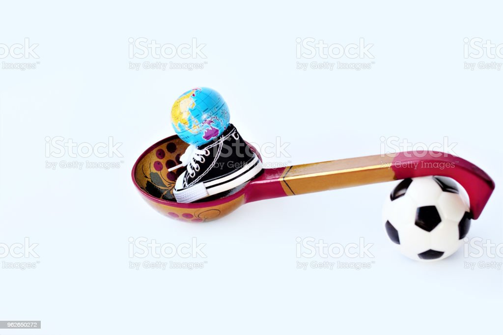 b3ac66732 Football Or Soccer Ball Sports Shoes Globe Ball With A Wooden Spoon ...