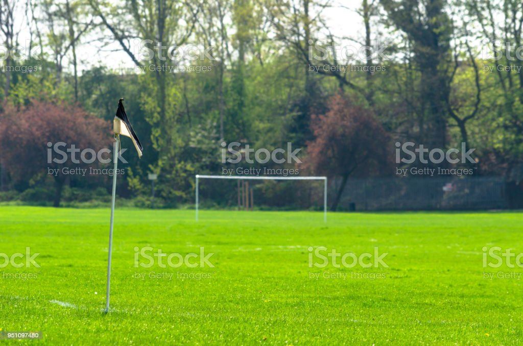 A football or soccer field in the park in springtime stock photo