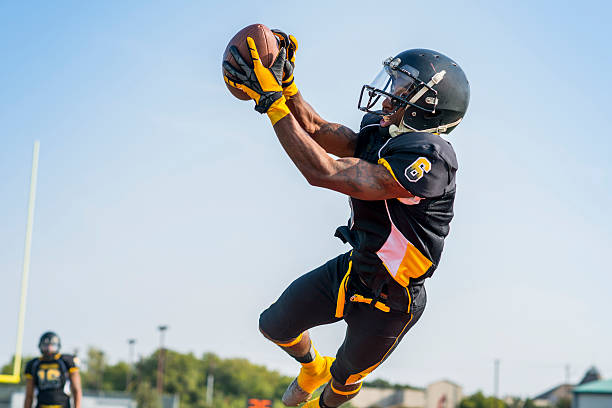 Football Men's football game. wide receiver athlete stock pictures, royalty-free photos & images