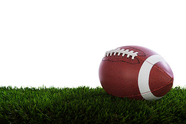 CFL Football CFL Football sitting on turf against a white background canadian football league stock pictures, royalty-free photos & images