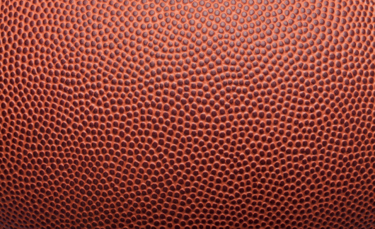 Pigskin texture from an American football. Great background for type and images.
