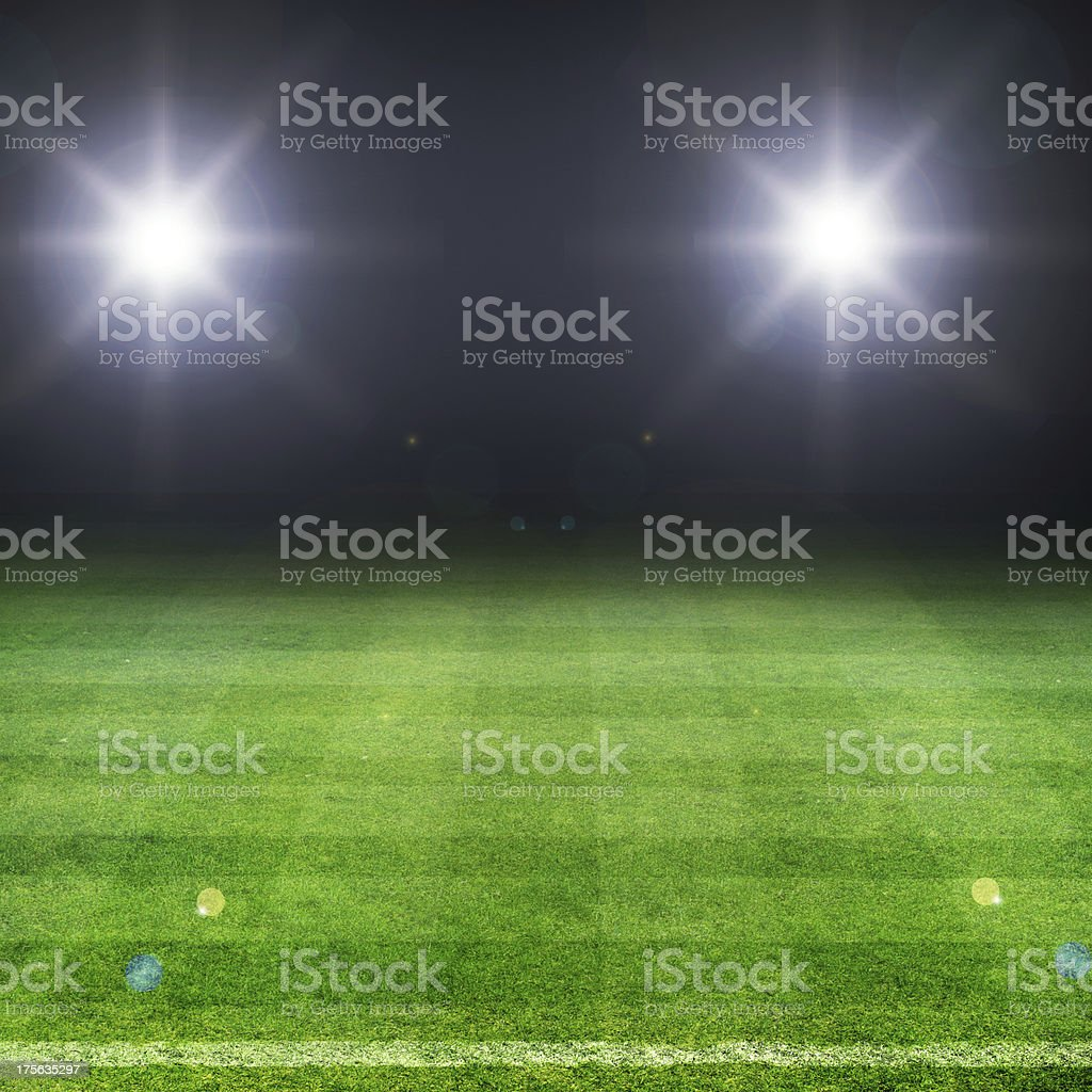 Football pitch at night with bright lights stock photo