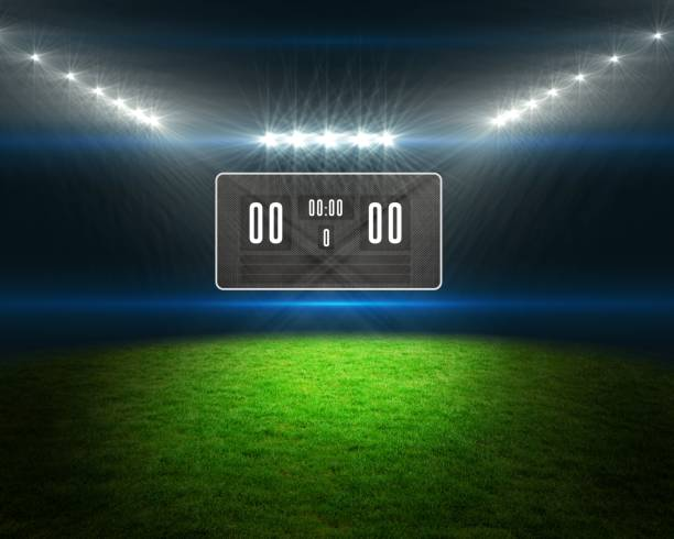 football pitch with scoreboard and lights - scoring stock photos and pictures