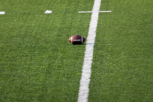 Football placed on field – Ready for the game stock photo