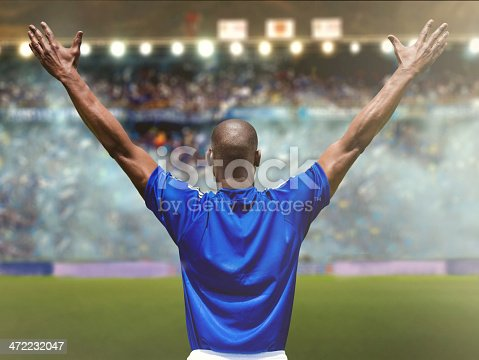 istock Football player at the stadium 472232047