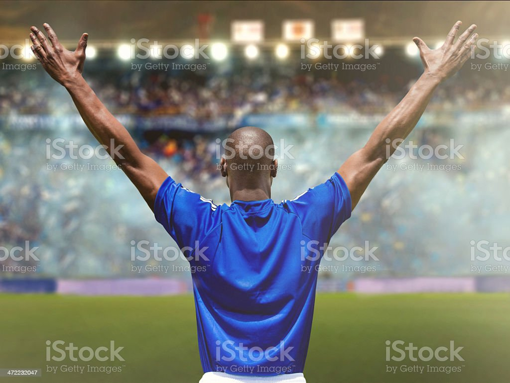 Football player at the stadium stock photo