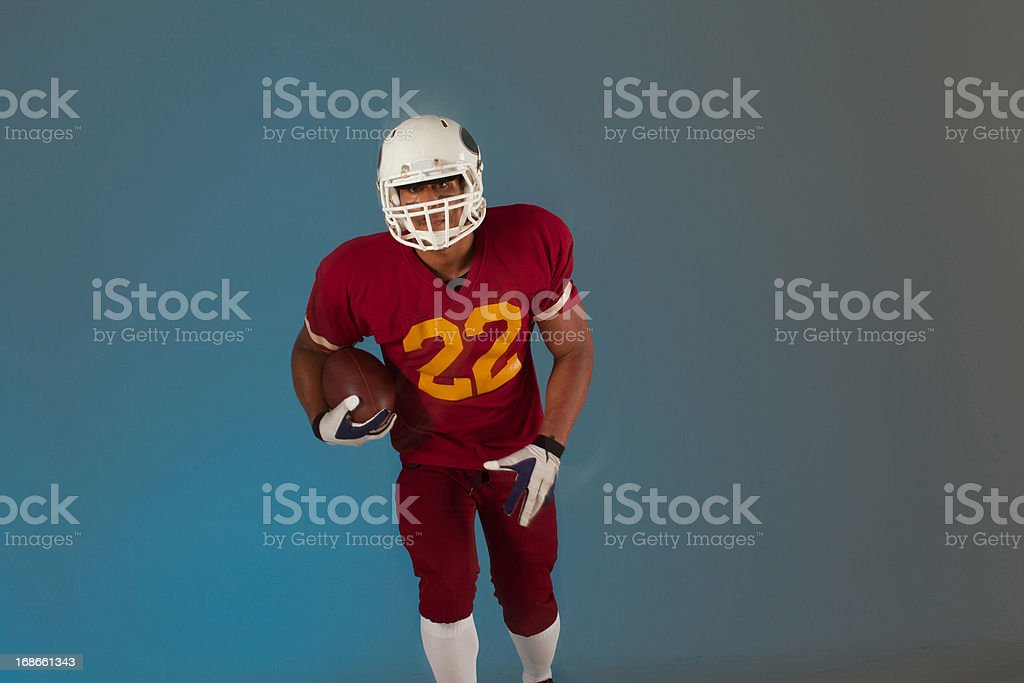 Football player carrying ball stock photo