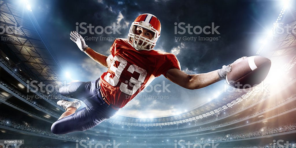 Football player catches a ball stock photo