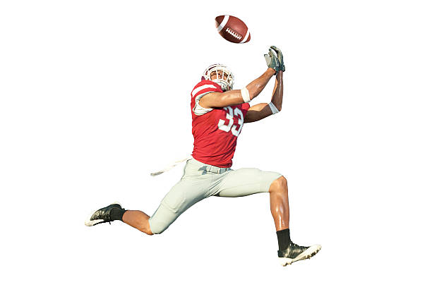 football player catching a ball - american football player stock photos and pictures