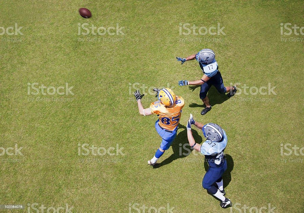 Football player catching football stock photo