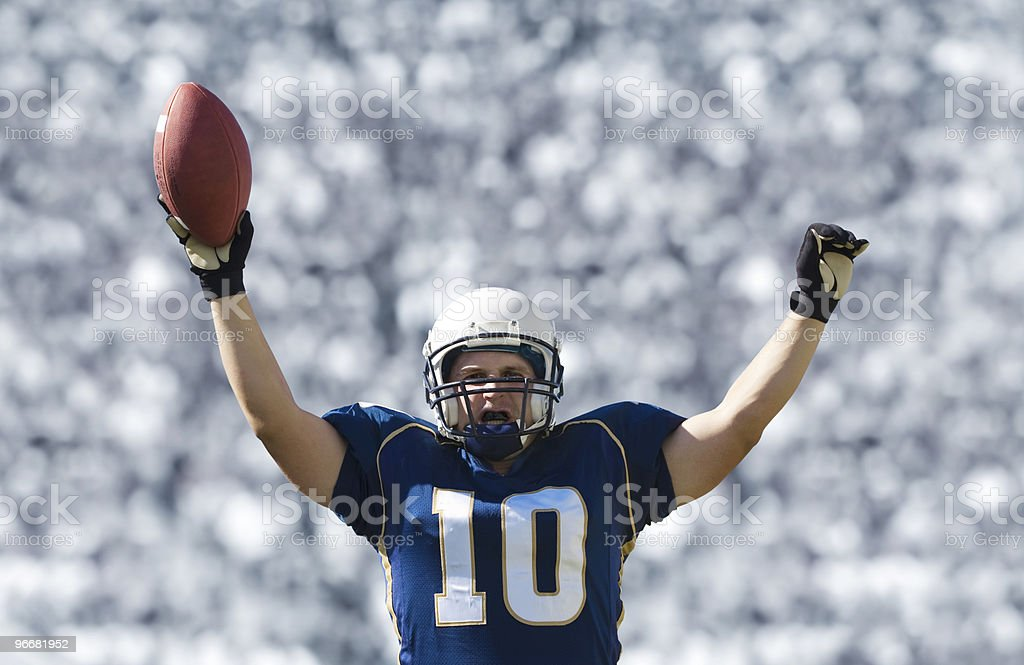 Football player celebrating a touchdown royalty-free stock photo