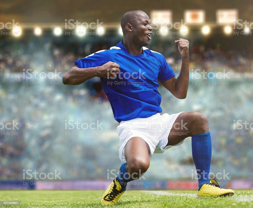 Football player celebrating stock photo