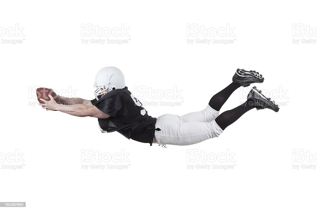 Football player diving to catch the ball stock photo