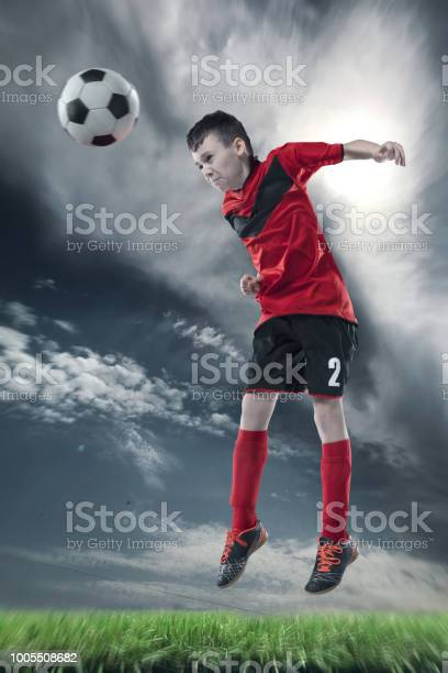 Football player hitting the ball with head on a soccer stadium picture id1005508682?b=1&k=6&m=1005508682&s=612x612&h=bkuepf vbmr2fs3lm0qpmv7gfdk6wntyg3ekh7pegfa=