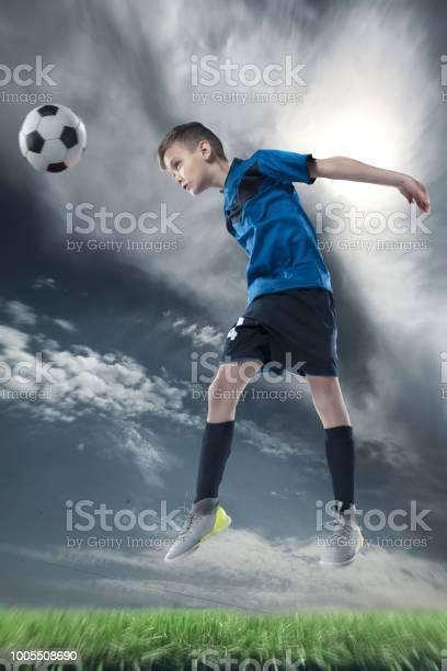 Football player hitting the ball with head on a soccer stadium picture id1005508690?b=1&k=6&m=1005508690&s=612x612&h=eyh05ppqluo6fa6lqd7weuyu7l6r6ccoub6m9fjtnsu=