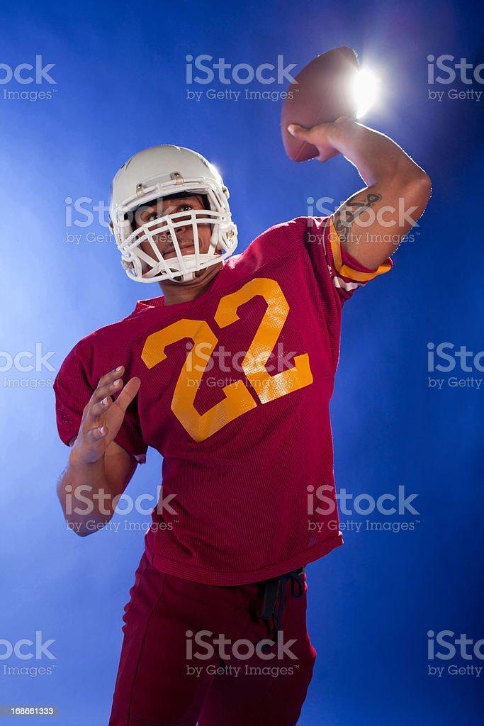 Football player holding ball royalty-free stock photo