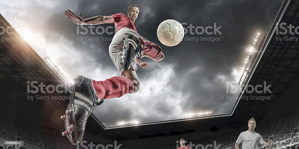 Football Player in Mid Air stock photo