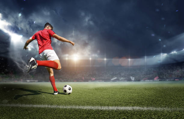 Football player in the stadium stock photo