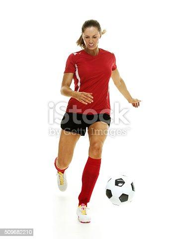 istock Football player kicking ball 509682210