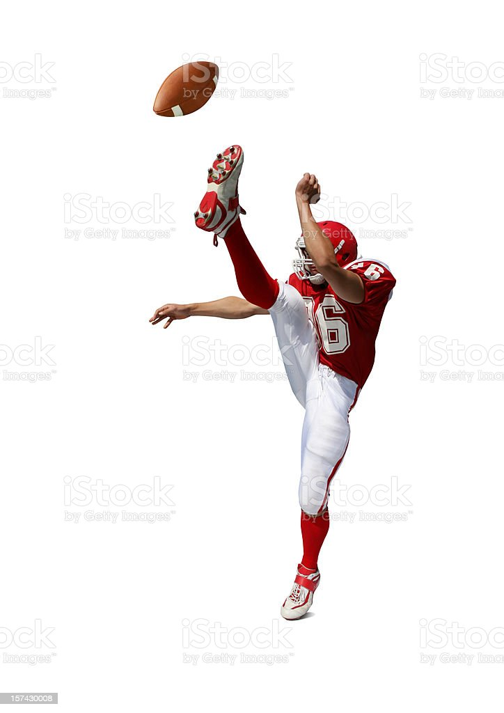 Football Player Kicking Ball with Clipping Path stock photo