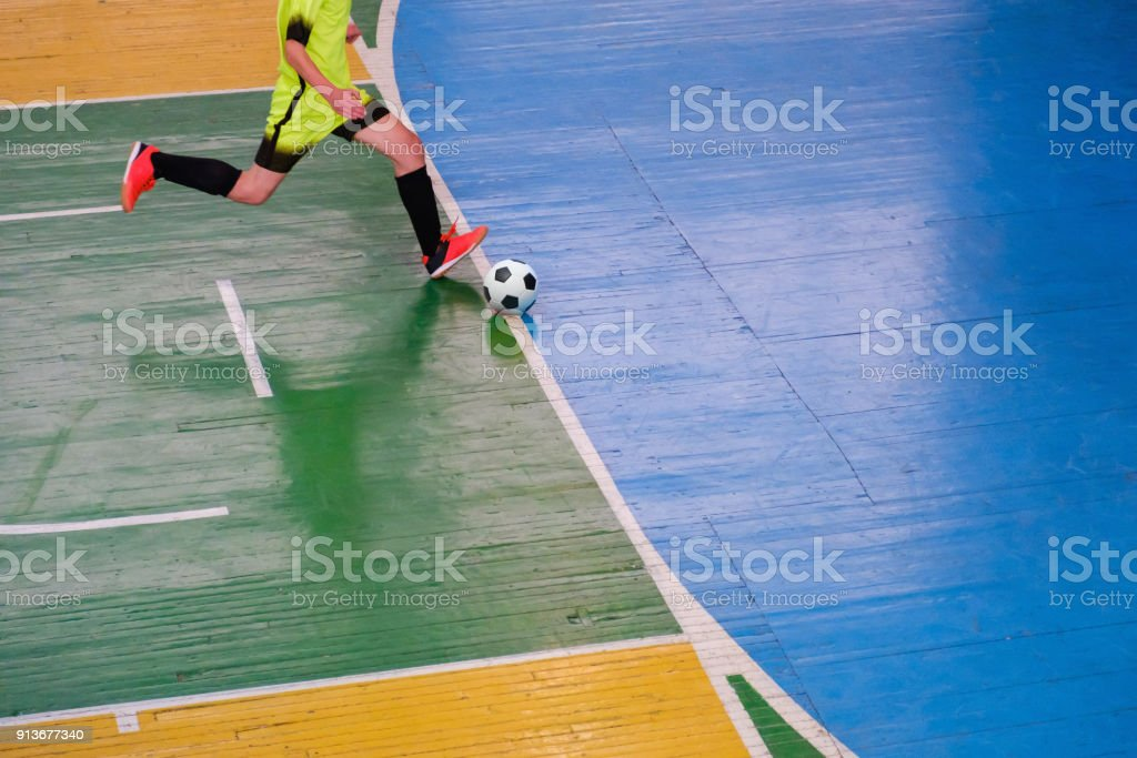 Football player on field Small, Futsal ball field in the gym indoor,...