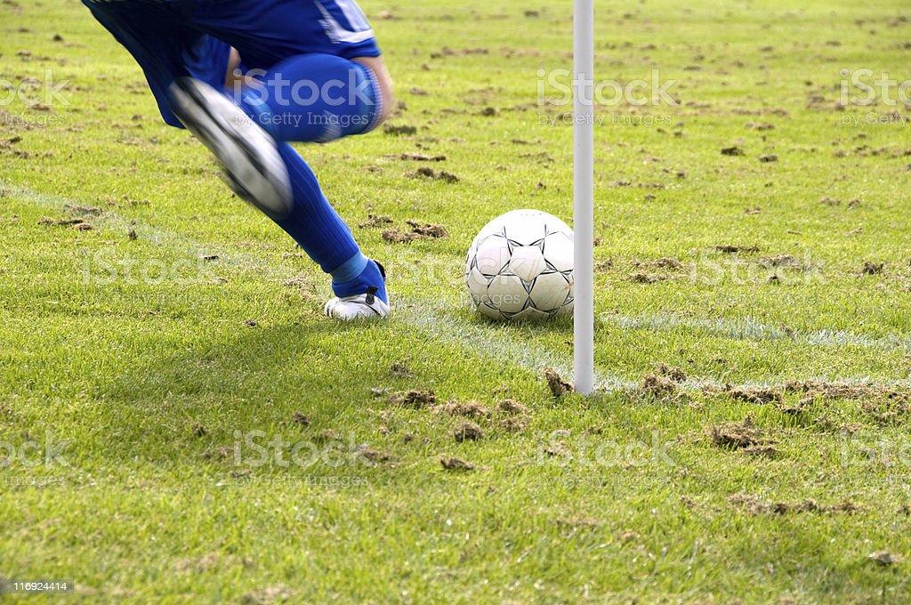 Football player performs a corner kick stock photo