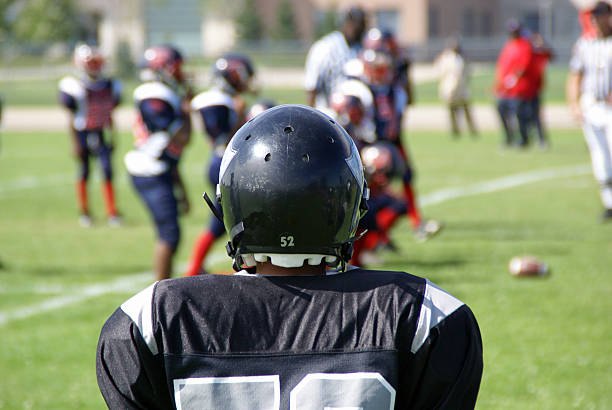 Football Player Football team member joining the game. american football player stock pictures, royalty-free photos & images
