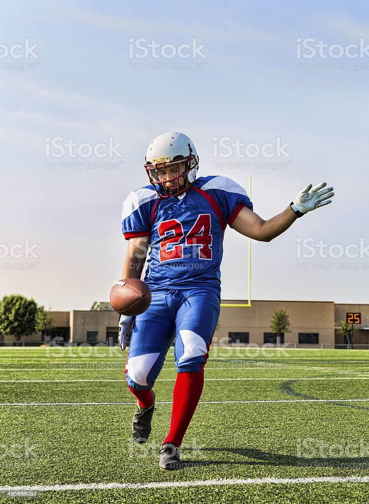 Football Player Punts the ball stock photo