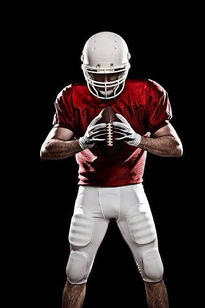 a football player ready to play - american football player stock photos and pictures