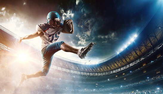 istock Football player runs with the ball 529662610
