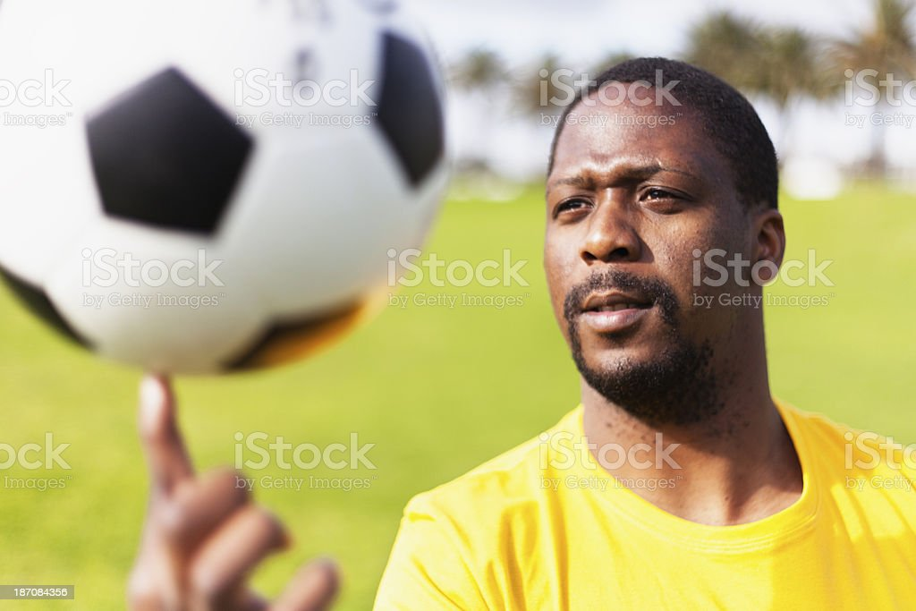 Football Player Spinning a Ball on his Finger royalty-free stock photo