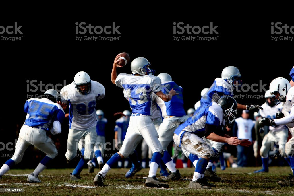 football player throwing the ball stock photo