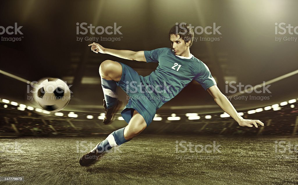 football player volleying ball stock photo