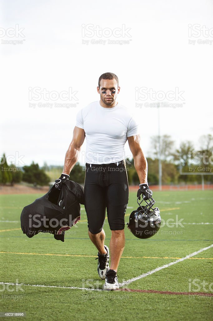 Football Player Walking Off the Field stock photo